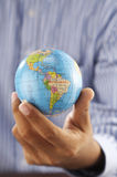 Hand and globe Stock Photography