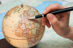 A hand and the globe Stock Photography