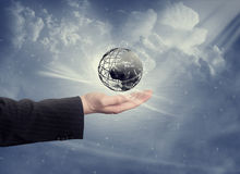 Hand with globe and clouds Royalty Free Stock Image