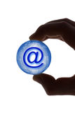 Hand with globe and e-mail symbol Stock Images