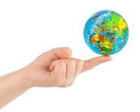 Hand and globe Stock Image