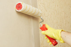 Hand in glothes lubricating wall Stock Image