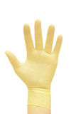 Hand in a glove. Royalty Free Stock Photos