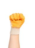 Hand in glove as fist. Isolated on a white background Royalty Free Stock Images