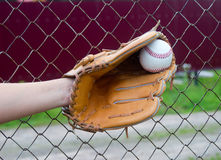Hand in glove with baseball Stock Photos