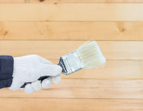 Hand in glove cotton holding brush paints Stock Photos