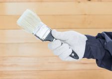 Hand in glove cotton holding brush paints Royalty Free Stock Image
