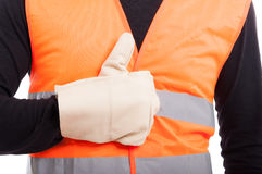 Hand with glove of engineer showing like sign. In close-up view on white background Royalty Free Stock Image