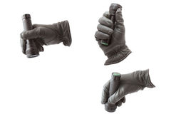 Hand in glove with a flashlight Stock Images