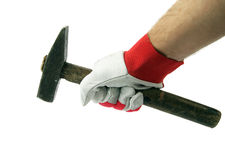 Hand in glove with hammer Royalty Free Stock Photos