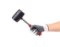 Hand in glove holding black hammer. Stock Photos