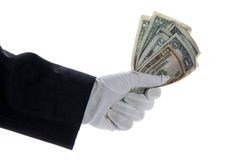 Hand with glove holding bunch of dollars Stock Photos