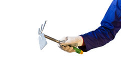 Hand in glove holding garden tool Royalty Free Stock Photo