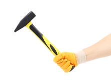 Hand in glove holding hammer. Stock Image
