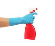 Hand in glove holding red plastic spray bottle. Stock Image