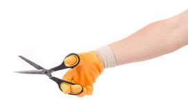 Hand in glove holding scissors. Royalty Free Stock Photos