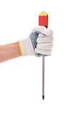 Hand in glove holding screwdriver. Royalty Free Stock Photos