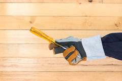 Hand in glove holding screwdriver Royalty Free Stock Photography