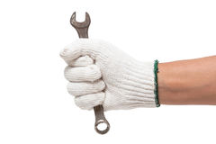 Hand in glove holding a spanner Stock Photography