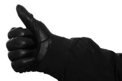 Hand with glove is holding up the thumb Royalty Free Stock Photo