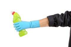 Hand in glove holds botlle. Stock Photos