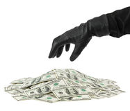Hand in glove and money stock photography