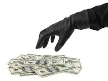 Hand in glove and money Royalty Free Stock Photos