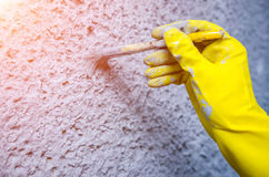 Hand in glove with a paint brush Royalty Free Stock Image