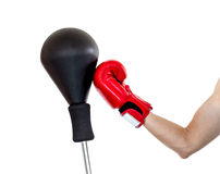 Hand in glove punch a punching ball Stock Images