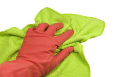 Hand in a glove with a rag. Hand in a pink rubber glove and a green rag. On a white background Stock Photography