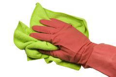 Hand in a glove with a rag. Hand in a pink rubber glove and a green rag. On a white background Royalty Free Stock Images