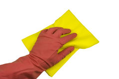 Hand in a glove with a rag. Hand in a pink rubber glove and a yellow rag. On a white background Royalty Free Stock Image