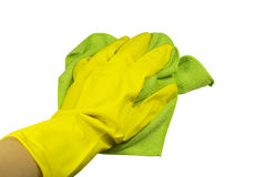 Hand in a glove with a rag. Hand in a yellow rubber glove and a green rag. On a white background Stock Photo