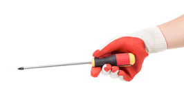 Hand in glove with red screwdriver. Royalty Free Stock Photo