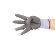 Hand in glove showing four. Stock Image