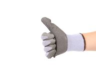 Hand in glove showing thumb's up sign. Stock Image