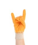 Hand in glove shows rock sign. Royalty Free Stock Images