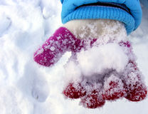 Hand with glove and snow Stock Images