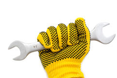 Hand in glove and spanner Stock Photos