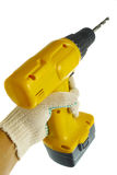 Hand in glove with wireless power drill isolated Royalty Free Stock Photo