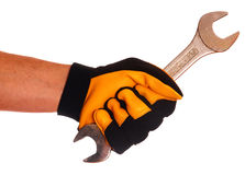 Hand with glove and wrench Stock Photography