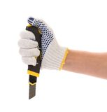 Hand in gloves holding knife. Royalty Free Stock Image