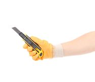 Hand in gloves holding knife. Stock Photos