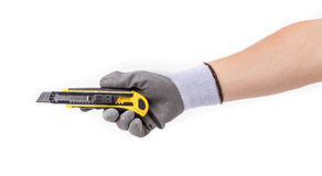 Hand in gloves holding knife. Stock Image
