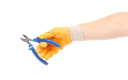Hand in gloves holding pliers. Royalty Free Stock Images