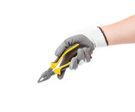 Hand in gloves holding pliers. Stock Images