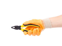 Hand in gloves holding pliers. Royalty Free Stock Photos