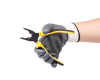 Hand in gloves holding pliers. Stock Photo
