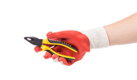 Hand in gloves holding pliers. Stock Photos