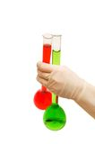 Hand in gloves holding tubes Stock Image
